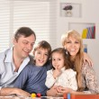 Family with cheerful children — Stock Photo