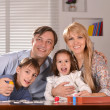 Family with cheerful children — Stock Photo #29185317