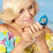 Older woman making up — Stock Photo