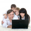 Family  resting a laptop — 图库照片
