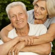 Interesting aged couple in the park — Stock Photo