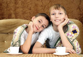 Cheerful boys drinking tea — Стоковое фото