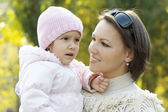 Mom and young daughter walking — Stock Photo