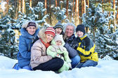 Happy family in winter outdoors — Stock Photo