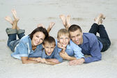 Nice family lying on the sand — Stock Photo