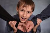 Little boy joins hands — Stock Photo