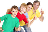 Amusing family in bright T-shirts — Stock Photo