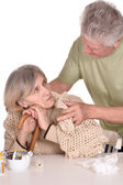 Older man caring for sick woman — Stock Photo
