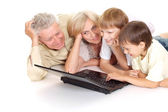 Grandchildren with their attractive granddad and granny — Stock Photo