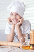 Boy knead the dough — Stock Photo