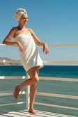 Beautiful woman enjoying the sea — Stock Photo
