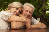 Pleasant elderly couple sitting on the veranda — Stock Photo