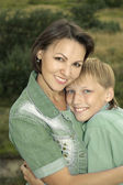 Happy mother and kid playing in the park — Stock Photo