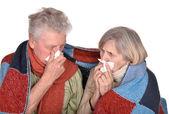 Elderly couple ill with influenza — Stock Photo