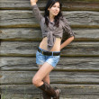 Cowgirl in denim shorts — Stock Photo