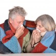 Elderly couple ill with influenza — Stockfoto