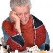 Stock Photo: Elderly caucasimtreated by medicines