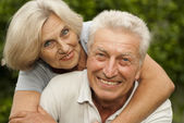 Sympothetic aged couple in the park — Stock Photo