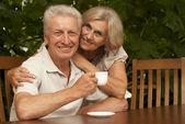 Good older couple sitting on the veranda — Stock Photo