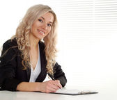 Smart blonde in office — Stock Photo