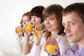 Boy and girls drink the juice — Stock Photo