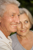 Amusing elderly couple in the garden — Stock Photo