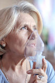 Woman making inhalation — Stock Photo