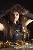 Beautiful lady as a witch — Stock Photo