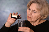Woman treated by medicines — Stock Photo