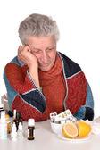 Elderly caucasian man treated by medicines — Stock Photo