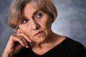 Portrait of an thinking elderly woman — Stock Photo