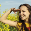 Stock Photo: Superb young female in middle of yellow flowers