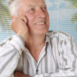 Mature gray-haired man on vacation — Stock Photo