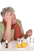 Elderly man treated by medicines — Stock Photo