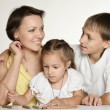 Mother drawing with her daughter and son — Stock Photo