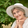 Old beautiful woman posing outdoors — Stock Photo