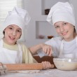 Two young boys knead the dough with a rolling pin for cookie — Stock Photo