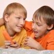 Brothers are happy and eating a carrot — Stock Photo