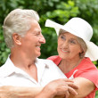 Happy elderly couple at nature — Stock Photo