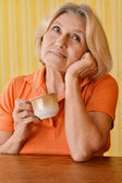 Happy woman in an orange drink tea — Stock Photo