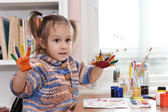Nice little girl draws paint in the room — Stock Photo
