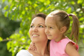 Beautiful young woman brought to walk her little daughter — Stock Photo