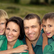 Happy parents and children — Stock Photo