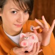 Woman with a piggy bank  — Foto de Stock
