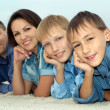 Stock Photo: Nice family of four lying