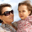 Beautiful young mother with child — Stock Photo