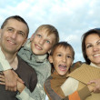 Happy parents and boys — Stock Photo