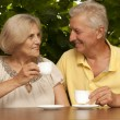 Adorable older couple sitting on the veranda — Stock Photo