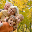 Elderly couple and boys resting in autumn — Stock Photo #29825471