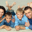 Nice family of four lying — Stock Photo